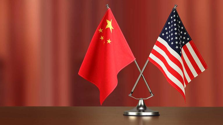 chinese_american_crossed_flag_on_desk_negotiation_studiocasper_istock_getty2.5e3c30e8e6b9f_1_